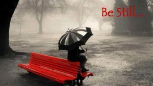 be-still-girl-sitting-on-red-bench